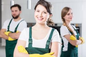 Happy young housekeeping girl